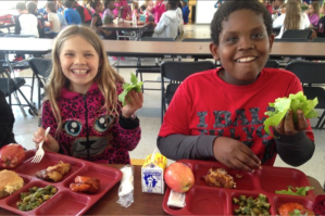 Photo 2. Students from the Della Davidson Elementary School in Oxford, Mississippi enjoy lunch, including lettuce from their school garden. Sunny Young.
